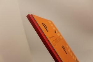 reliure bodonienne sur carnet rouge et orange
